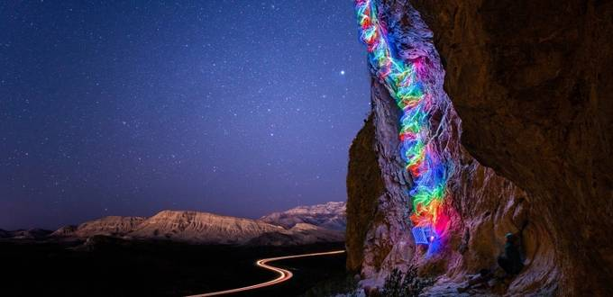 Climber turns route into a rainbow with LED lights
